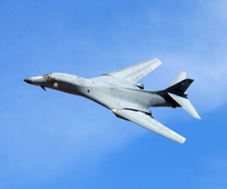A B-1 Lancer bomber performs a fly-by.