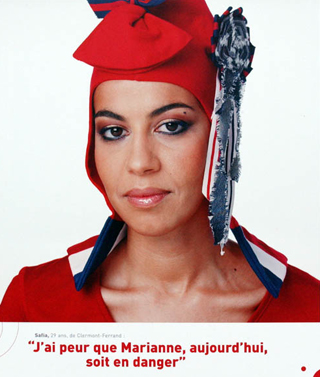 A Muslim woman dressed as Marianne wearing a phrygian cap. Text below reads 'I'm afraid Marianne today is in danger'.