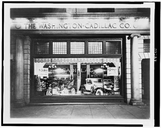 Black and white photo of a card dealership.