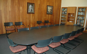 This photo shows the classroom for this course, which has seating for 14 around a central seminar table.