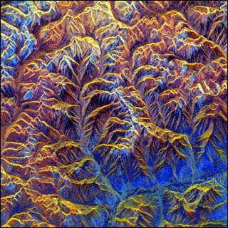 Colorful image of mountainous landscape taken from above.