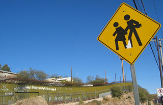 Roadside sign at the U.S.-Mexico border.