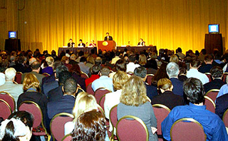 Speaker presenting to a large audience.