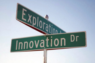 Street signs showing the corner of Exploration and Innovation Dr.