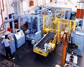 Several large machines in a manufacturing plant.