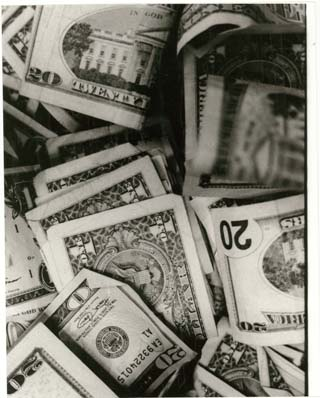 Image of scattered US currency.