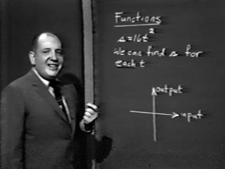 Image of Herb Gross in front of the chalkboard.